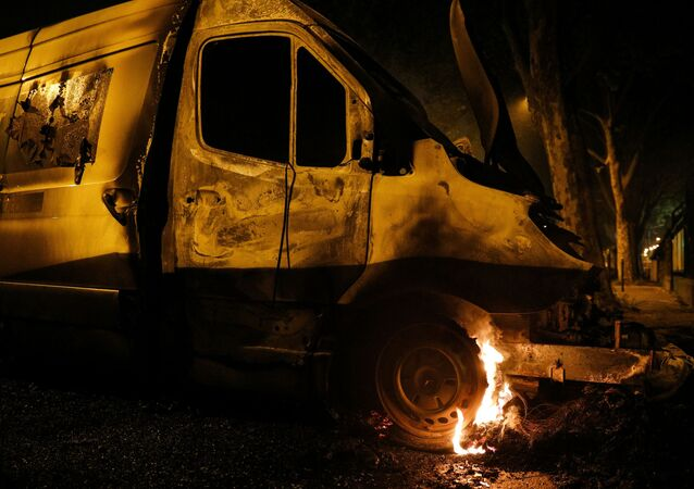 The wheel of a van burns in Villeneuve-la-Garenne, in the northern suburbs of Paris, early on April 20, 2020