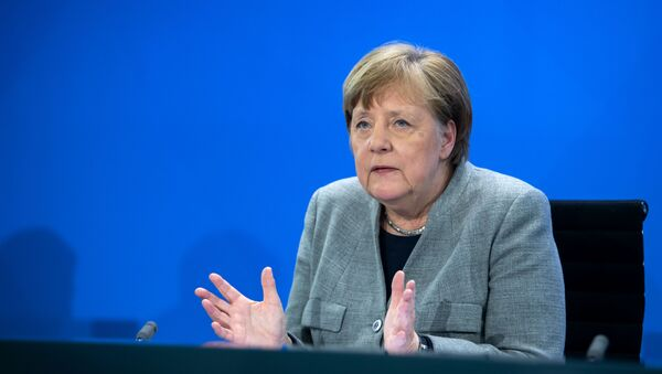 German Chancellor Angela Merkel addresses a press conference on German government's measures to avoid further spread of the novel coronavirus COVID-19, on April 15, 2020 following a video conference with the leaders of the German federal states at the chancellery in Berlin. - Sputnik International