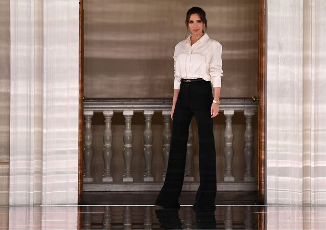 British fashion designer Victoria Beckham reacts after presenting creations for her Autumn/Winter 2020 collection on the third day of London Fashion Week in London on February 16, 2020.
