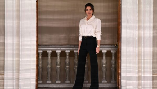 British fashion designer Victoria Beckham reacts after presenting creations for her Autumn/Winter 2020 collection on the third day of London Fashion Week in London on February 16, 2020.  - Sputnik International