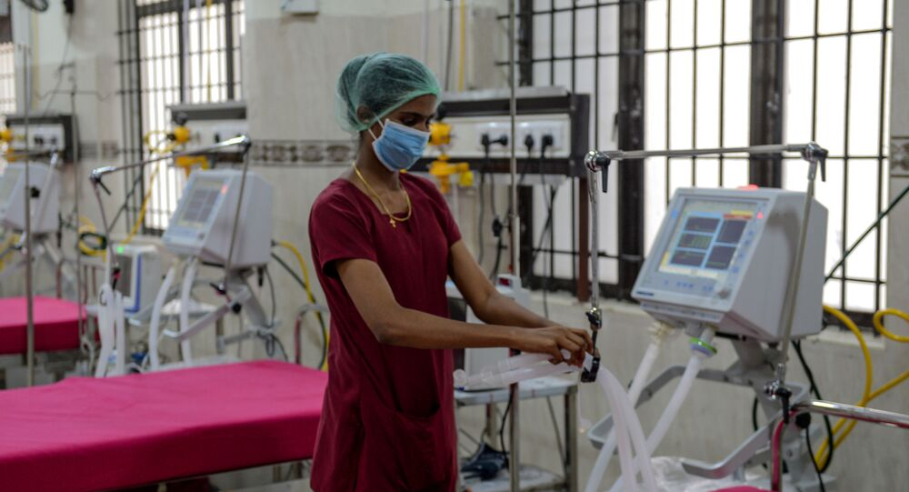 A medical staff checks on a ventilator of an intensive care unit at a newly inaugurated hospital by the Tamil Nadu state during a government-imposed nationwide lockdown as a preventive measure against the COVID-19 coronavirus, in Chennai on March 27, 2020
