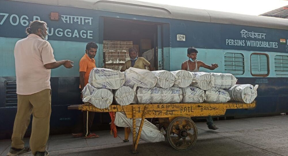 Porters loading essential supplies in Covid-19 Parcel Special train at the New Delhi Railway Station