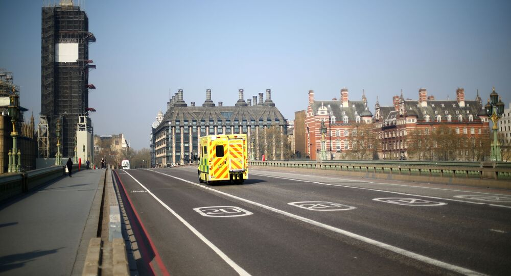 An ambulance is seen on Westminster bridge as the spread of the coronavirus disease (COVID-19) continues, in London, Britain April 9, 2020
