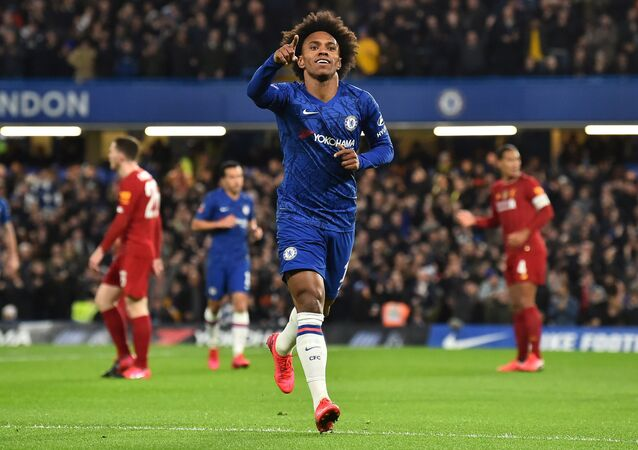 Chelsea's Brazilian midfielder Willian celebrates scoring the opening goal against Liverpool in March 2020
