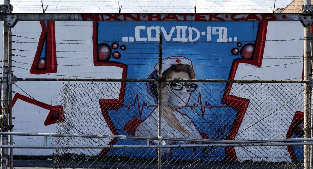 A COVID-19 mural is seen in Chicago Logan Square, Friday, April 10, 2020.