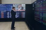 A man stands in the viewing gallery at the Australian Stock Exchange in Sydney, Monday, March 9, 2020