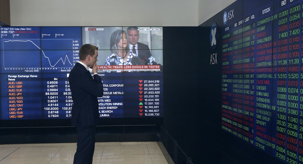 A man stands in the viewing gallery at the Australian Stock Exchange in Sydney, 9 March 2020