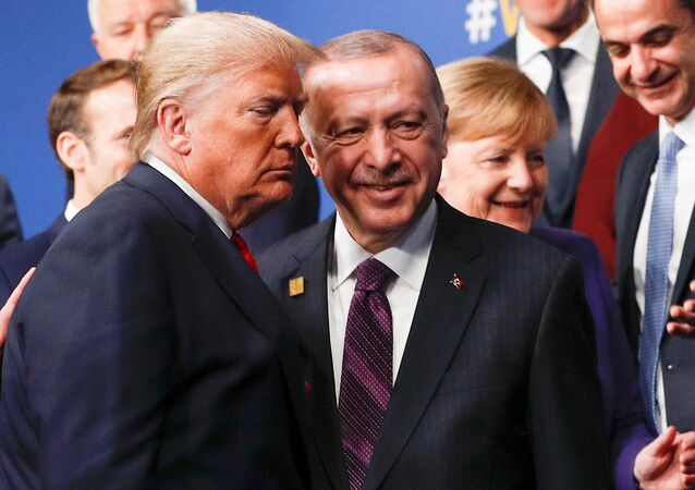 U.S. President Donald Trump and Turkey's President Recep Tayyip Erdogan leave the stage after family photo during the annual NATO heads of government summit at the Grove Hotel in Watford, Britain December 4, 2019