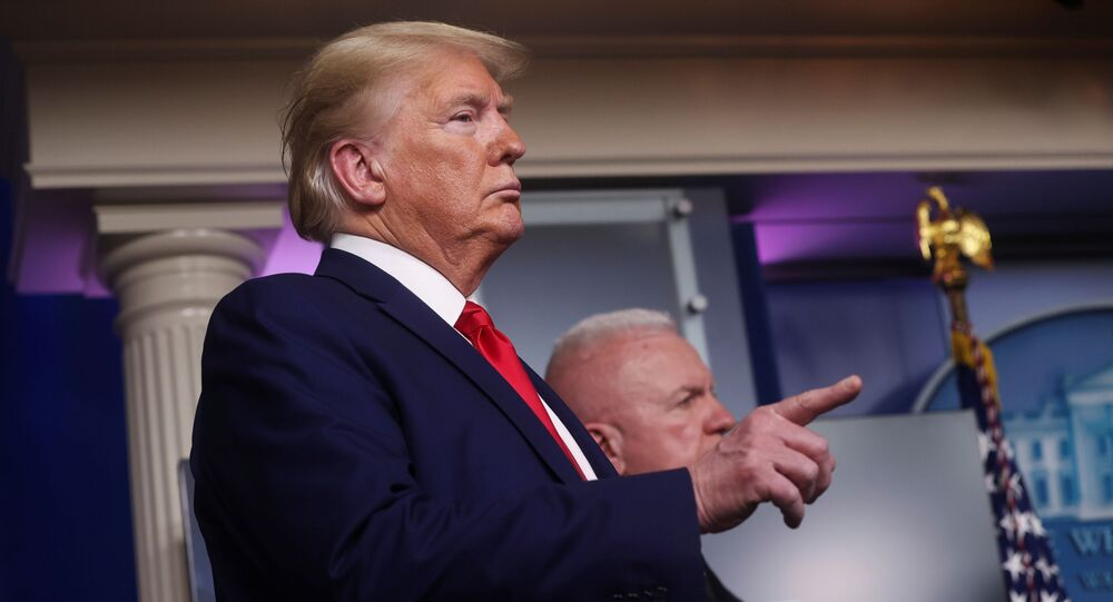 U.S. President Donald Trump participates in the daily coronavirus task force briefing with U.S. Assistant Secretary for Health Admiral Brett Giroir at his side at the White House in Washington, U.S., April 20, 2020