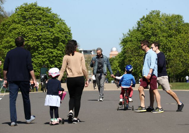 People are seen in Kensington Palace Park, as the spread of the coronavirus disease (COVID-19) continues, London, Britain, April 19, 2020.