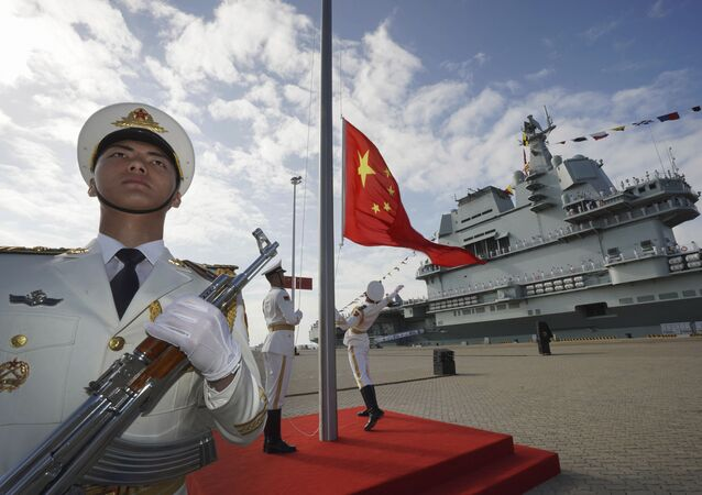 In this photo taken Dec. 17, 2019 and released Dec. 27, 2019 by Xinhua News Agency, Chinese honor guard raise the Chinese flag during the commissioning ceremony of China's Shandong aircraft carrier at a naval port in Sanya, south China's Hainan Province