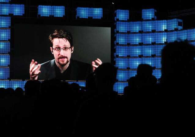 FILE - In this Nov. 4, 2019, file photo, former U.S. National Security Agency contractor Edward Snowden addresses attendees through video link at the Web Summit technology conference in Lisbon