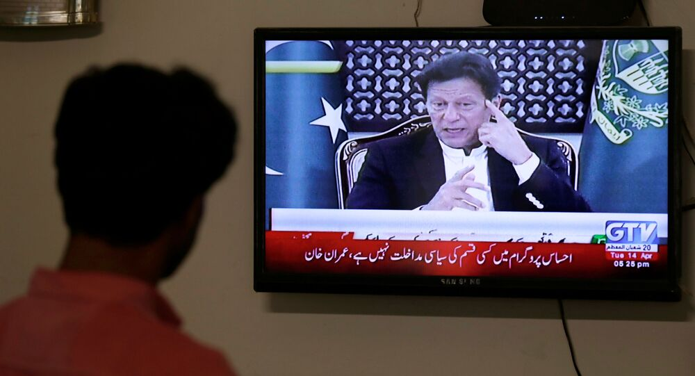 A television screen displays Prime Minister of Pakistan Imran Khan, announcing the extension of a country-wide lockdown for two weeks, due to the ongoing spread of the coronavirus disease (COVID-19), in Karachi, Pakistan April 14, 2020