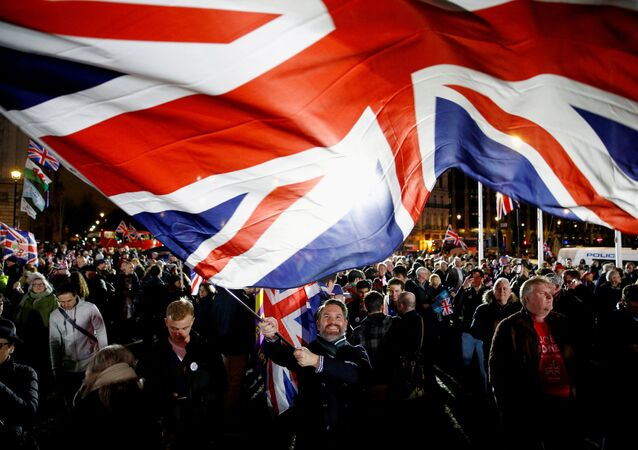 A man waves a British flag on Brexit day in London, Britain January 31, 2020