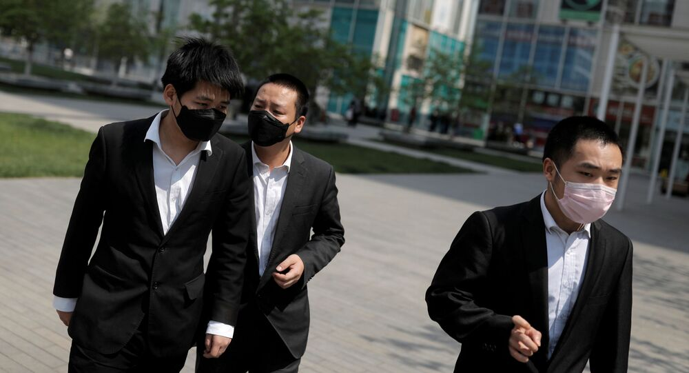 Office workers wear protective during lunch hour near Beijing's Central Business District as the spread of the new coronavirus disease (COVID-19) continues in China, April 17, 2020