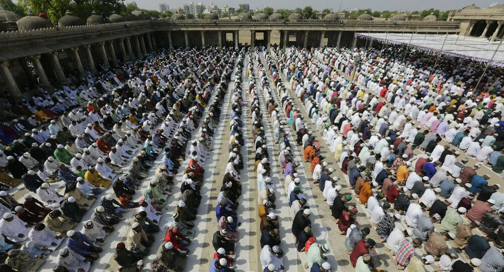 Indian Muslims offer Eid al-Fitr prayers at the Sarkhej Roza in Ahmadabad, India, Wednesday, June 5, 2019. Eid al-Fitr marks the end of the fasting month of Ramadan.