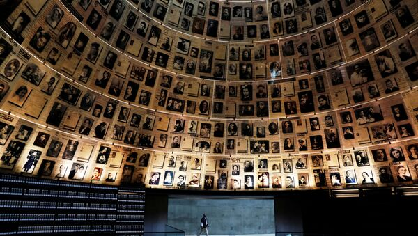 A security personnel walks at the Hall of Names at the Yad Vashem World Holocaust Remembrance Center in Jerusalem, before beginning of Israel's annual Holocaust Remembrance Day, as the centre is closed following the coronavirus disease (COVID-19) restrictions around the country, April 20, 2020 - Sputnik International
