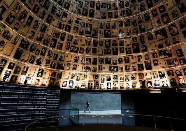 A security personnel walks at the Hall of Names at the Yad Vashem World Holocaust Remembrance Center in Jerusalem, before beginning of Israel's annual Holocaust Remembrance Day, as the centre is closed following the coronavirus disease (COVID-19) restrictions around the country, April 20, 2020