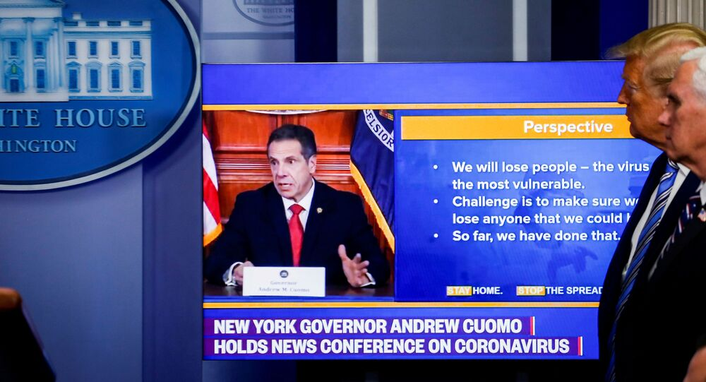 U.S. President Donald Trump and U.S. Vice President Mike Pence watch a video of New York governor Andrew Cuomo speaking at Cuomo's daily briefing, during the daily coronavirus disease (COVID-19) task force briefing at the White House in Washington, U.S., April 19, 2020.
