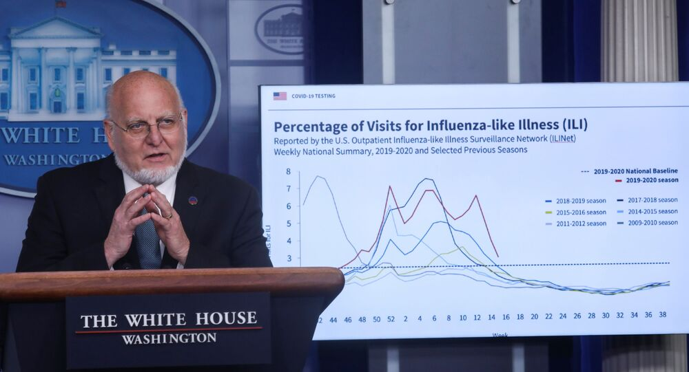 Centers for Disease Control (CDC) Director Robert Redfield explains illness surveillance programs in the United States in front of a chart showing statistics of patients seeking treatment for influenza-like illnesses during the daily coronavirus task force briefing at the White House in Washington, U.S., April 17, 2020.