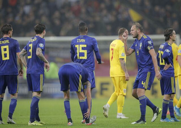 Sweden's Andreas Granqvist, right, gestures after referee Daniele Orsato stops the game following alleged racist chants against Sweden's Alexander Isak , center left, during the Euro 2020 group F qualifying soccer match between Romania and Sweden on the National Arena stadium in Bucharest, Romania, Friday, Nov. 15, 2019.