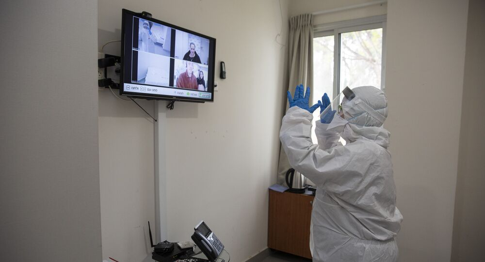 Israeli Professor Galia Rahavm, head of infectious diseases, shows one of the rooms where returning Israelis with suspected exposure to Coronavirus will stay under observation and isolation, at the Chaim Sheba Medical Center at at Tel Hashomer in Ramat Gan, Israel, Wednesday, Feb. 19, 2020. I
