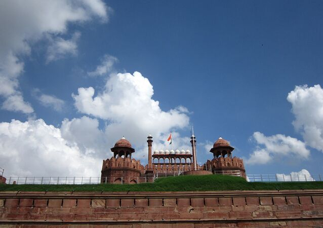 Indian national Flag waving under clear blue sky on Red Fort, Delhi