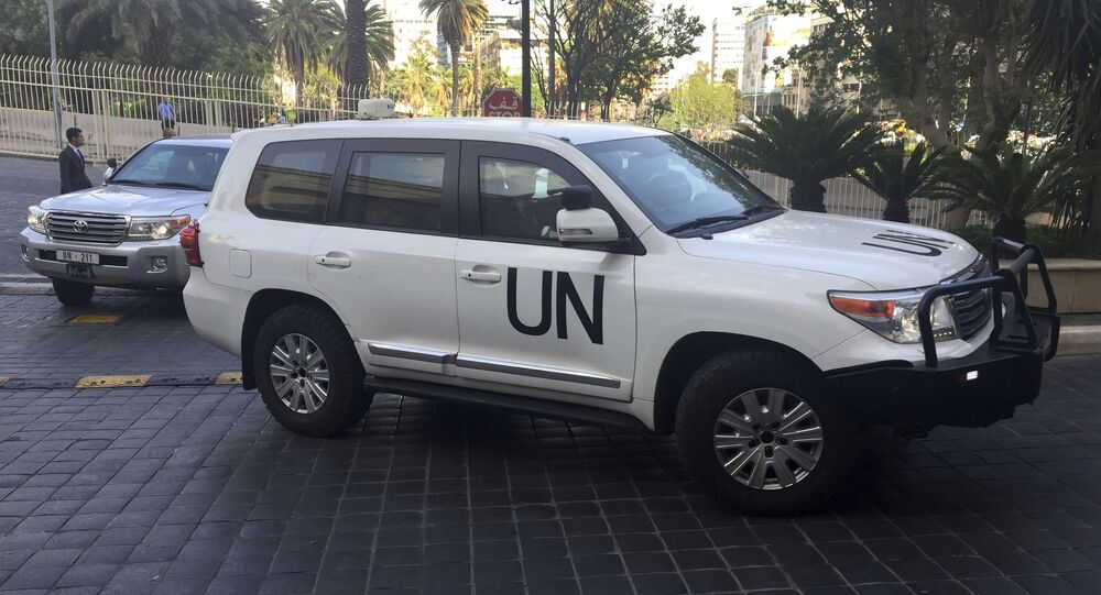 United Nations vehicles carry the team of the Organization for the Prohibition of Chemical Weapons (OPCW)