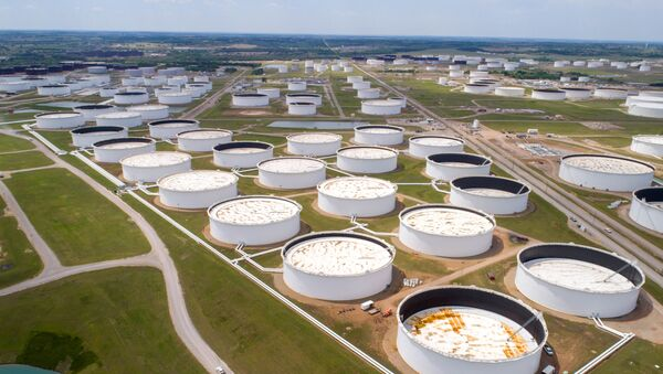 Crude oil storage tanks are seen in an aerial photograph at the Cushing oil hub in Cushing, Oklahoma, U.S. April 21, 2020. - Sputnik International