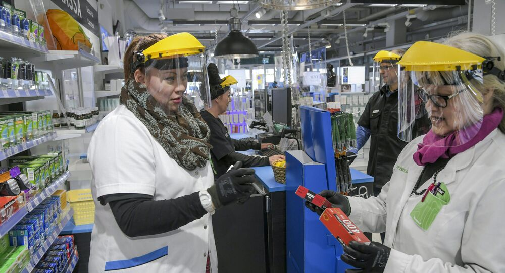 Workers wearing protective clothing are seen, as the spread of the coronavirus disease (COVID-19) continues, in Vantaa, Finland April 1, 2020