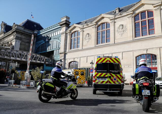 The ambulances escorted by police arrive at the Gare d'Austerlitz train station to evacuate patients from Paris region hospitals to Brittany, as the spread of the coronavirus disease (COVID-19) continues, in Paris, France 1 April 2020.