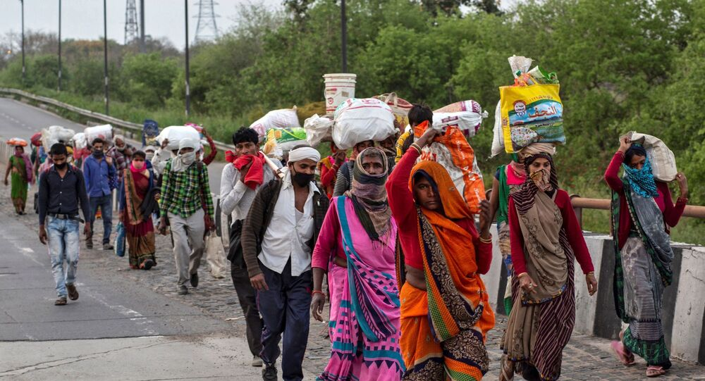 Friends and relatives of a Kushwaha family who work as migrant workers walk along a road to return to their villages, during a 21-day nationwide lockdown to limit the spreading of coronavirus, in New Delhi, India, 26 March 2020