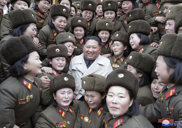 In this undated photo provided Nov. 25, 2019, by the North Korean government, North Korean leader Kim Jong Un, center, poses as he inspects a women's company under Unit 5492 of the Korean People's Army in North Korea