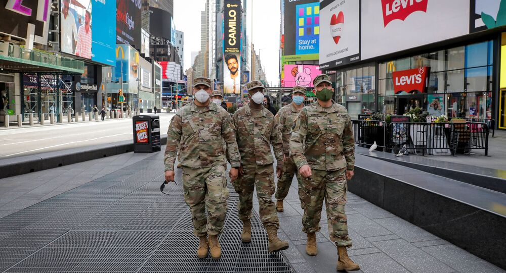 New York State Army National Guard soldiers walk through Times Square, during the outbreak of the coronavirus disease (COVID-19) in New York City, New York, U.S., April 20, 2020