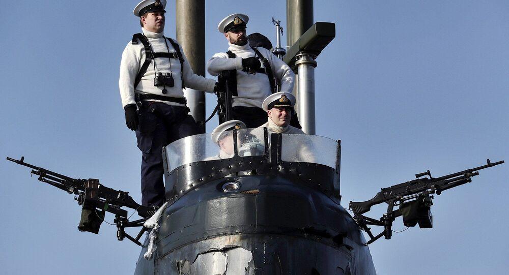 Crew of the UK Royal Navy nuclear-powered fleet submarine HMS Trenchant.