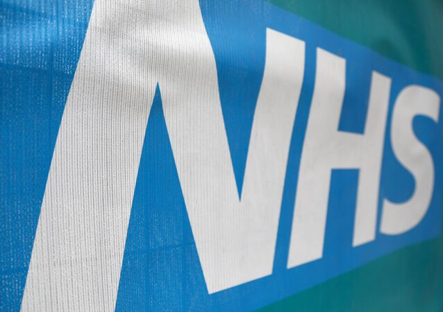 An NHS logo is displayed outside a hospital in London, Britain May 14, 2017.