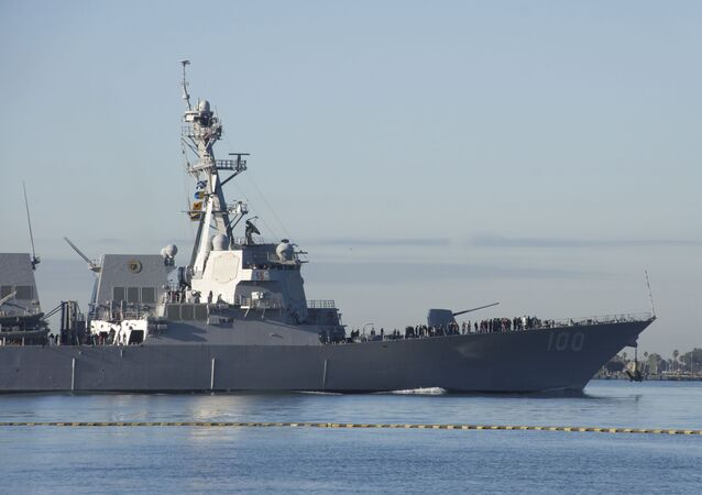 The guided-missile destroyer USS Kidd (DDG 100) departs San Diego Bay.
