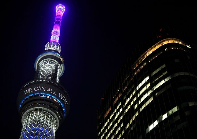 A message reading Together we can all win is displayed at the Tokyo Skytree after Japan's Prime Minister Shinzo Abe declared a state of emergency to fight the coronavirus disease (COVID-19), in Tokyo, Japan April 7, 2020