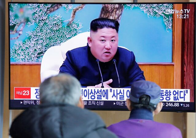 South Korean people watch a TV broadcasting a news report on North Korean leader Kim Jong Un in Seoul, South Korea, April 21, 2020