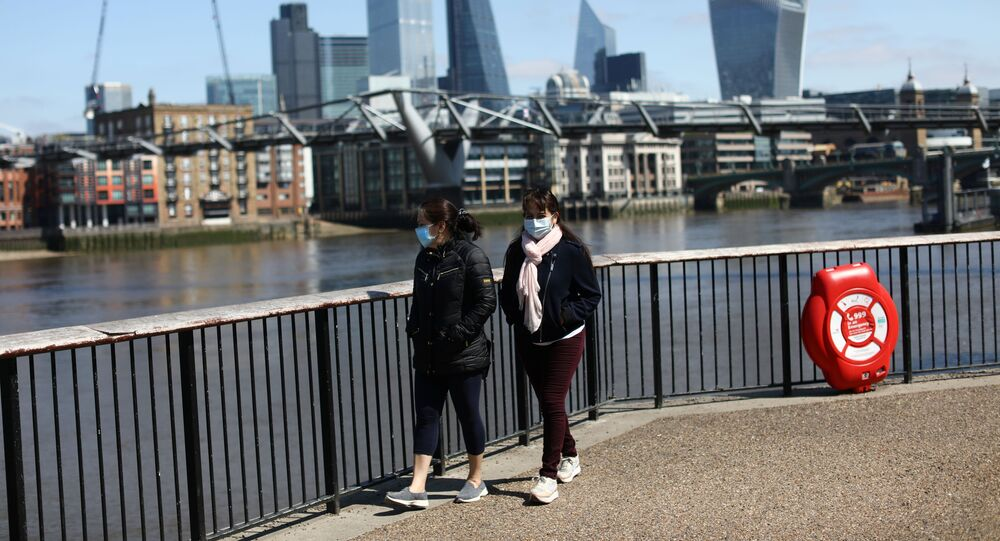 People are seen walking along the South Bank, as the spread of the coronavirus disease (COVID-19) continues, in London, Britain, April 25, 2020. REUTERS/Simon Dawson