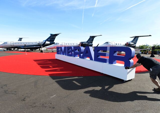 Workers set up at the Embraer booth prior to the opening of the National Business Aviation Association (NBAA) exhibition in Las Vegas, Nevada, U.S. October 21, 2019.