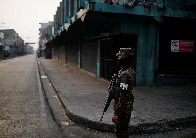 A military police officer stands close to a checkpoint during a police and army joint operation as part of security measures to keep people out of the city downtown markets during a quarantine throughout the country to curb the spread of the coronavirus disease (COVID-19), in San Salvador, El Salvador April 22, 2020.