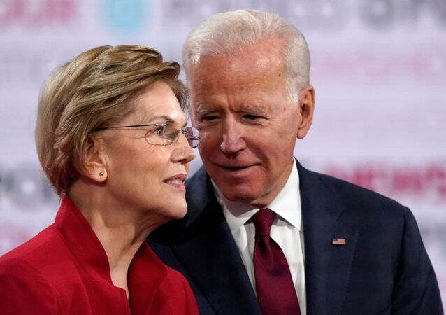 Democratic U.S. presidential candidates Senator Elizabeth Warren and former Vice President Joe Biden talk onstage before the start of the sixth Democratic presidential candidates campaign debate at Loyola Marymount University in Los Angeles, California, U.S., December 19, 2019.