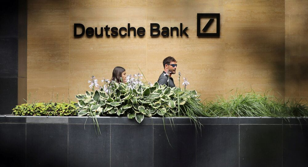 People walk past a Deutsche Bank office in London, Britain July 8, 2019