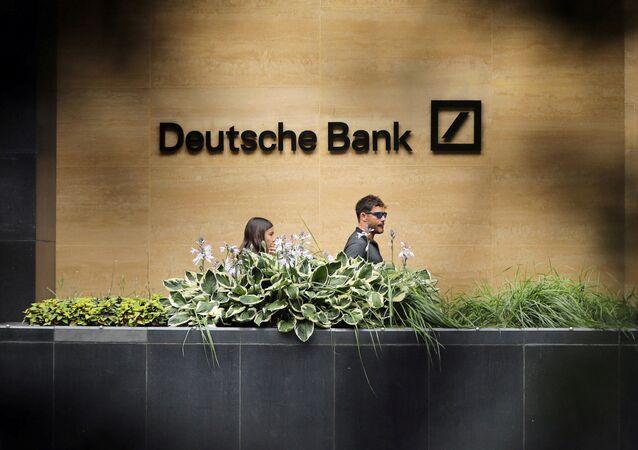 People walk past a Deutsche Bank office in London, Britain July 8, 2019