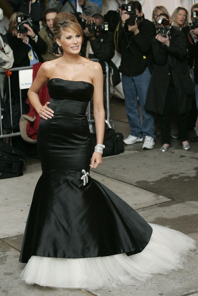 Melania Trump poses for pictures as she arrives at the Costume Institute Gala held at the Metropolitan Museum of Art in New York, Monday , May 2, 2005.