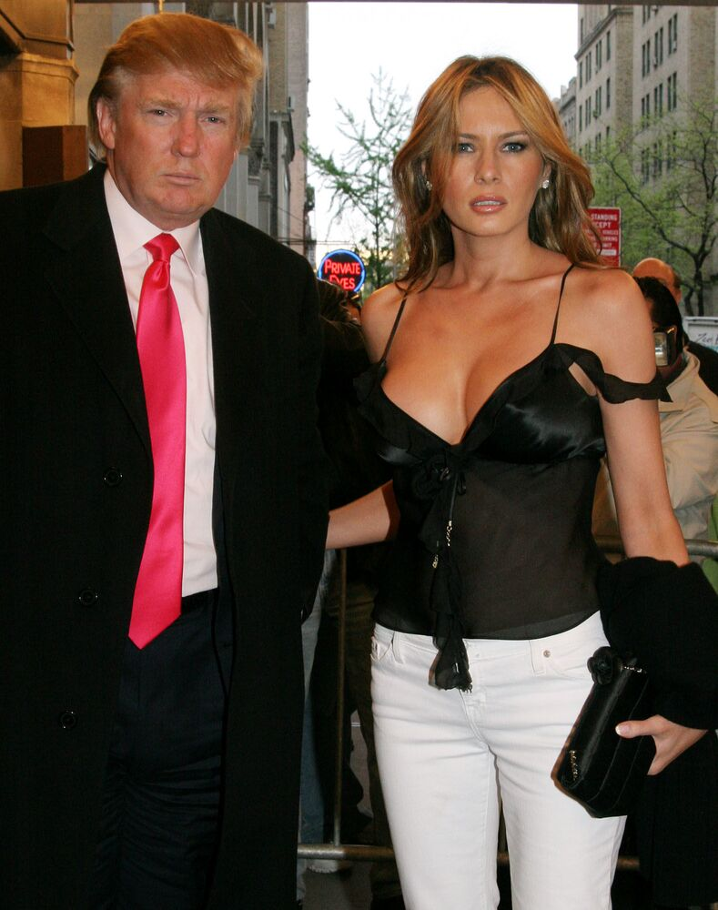 Donald Trump, left, and his wife Melania pose for photographers as they arrive for the opening night performance of Sweet Charity starring Christina Applegate at The Al Hirschfeld Theatre in New York, Wednesday May 4, 2005. The show is Applegate's Broadway debut.