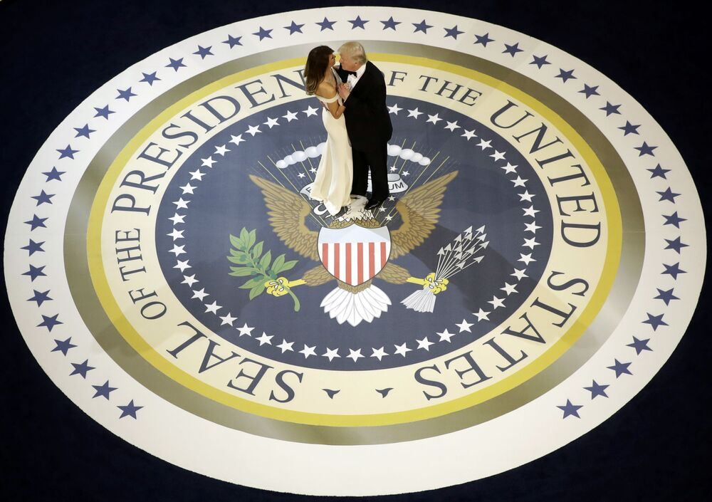 President Donald Trump dances with first lady Melania Trump, at The Salute To Our Armed Services Inaugural Ball in Washington, on Jan. 20, 2017.