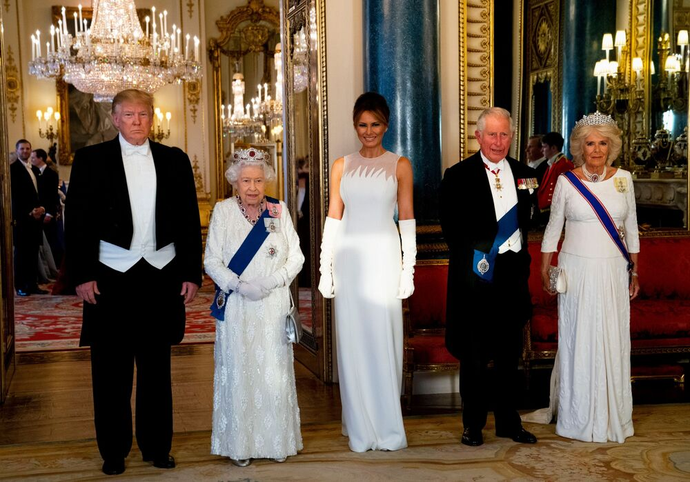 Britain's Queen Elizabeth II (2L), US President Donald Trump (L), US First Lady Melania Trump (C), Britain's Prince Charles, Prince of Wales (2R) and Britain's Camilla, Duchess of Cornwall pose for a photograph ahead of a State Banquet in the ballroom at Buckingham Palace in central London on June 3, 2019, on the first day of the US president and First Lady's three-day State Visit to the UK.