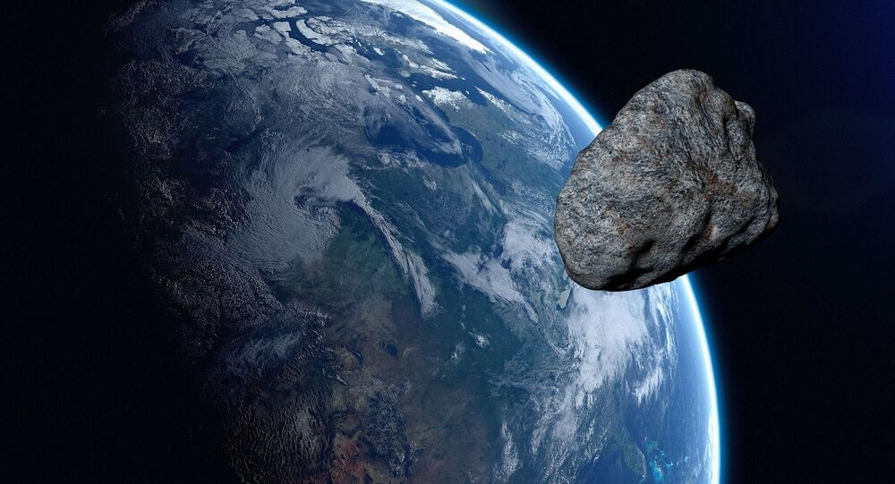 Giant asteroid set to race past earth